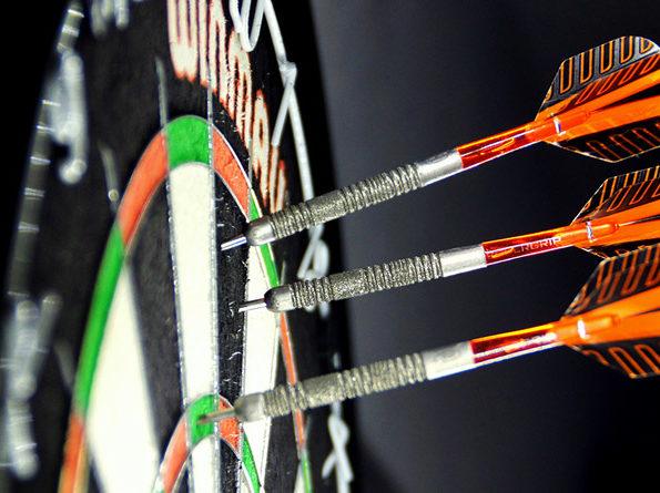 Three darts sticking out of a dart board - high score